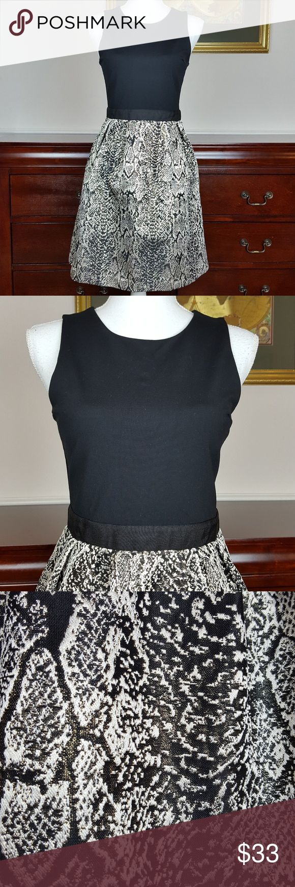 """Donna Ricco Tank Dress with Metallic Skirt Size S Great party dress. Black tank over black and gold metallic skirt. Grosgrain waistband. Back zip. Lined. Size Small. Excellent Condition. Approximate Measurements: Armpit to Armpit 16"""" Waist 14"""" Across Flat  Hip 17"""" Across Flat  Length 35"""" Donna Ricco Dresses"""