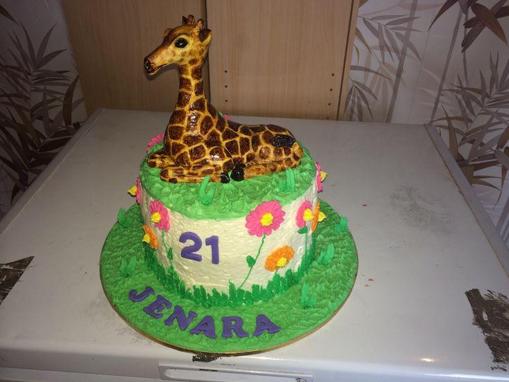 21st cake I made for a friend. Fondant giraffe, buttercream icing over a chocolate mud cake.