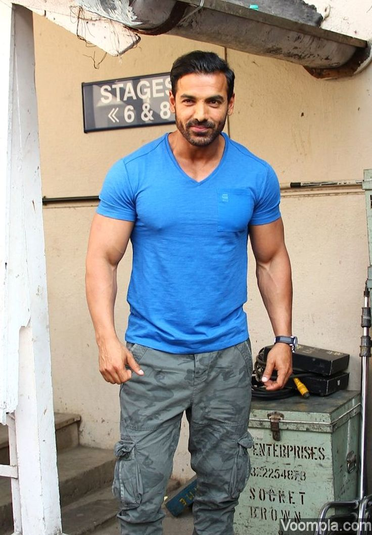 John Abraham shows off biceps and muscular physique in a tight blue T-shirt and military style cargo pants! via Voompla.com
