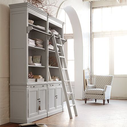 The Arhaus Athens Library in Nimbus includes a grand bookcase with a library-style sliding ladder & large cabinet base for extra storage.
