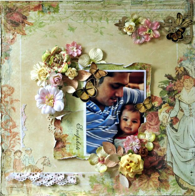 A layout featuring DH & Aneeka baby using Prima Patterened Papers & Flowers