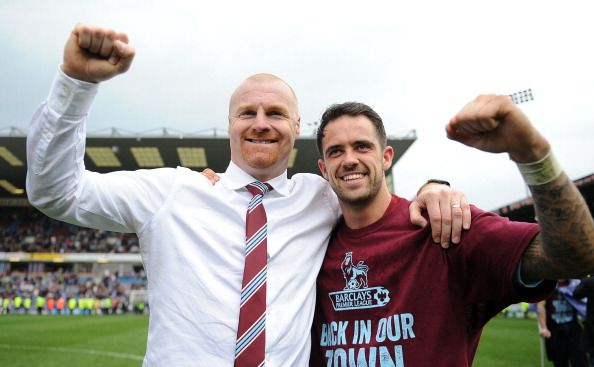 Burnley manager Sean Dyche celebrates with Danny Ings following the Sky Bet Championship match between Burnley and Wigan Athletic at Turf Moor on April 21, 2014 in Burnley, England.