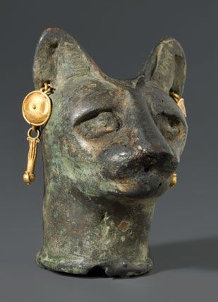 Cat's Head/Glass or semiprecious stone inlays in the eyes once enhanced this cat's lifelike appearance. The realistically rendered head also contains symbolic elements that are not immediately apparent; the incised details of fur on the ears evoke the shape of an ostrich feather, the hieroglyph for the goddess Maat—another daughter of the sun god Re, and the personification of truth and harmony.