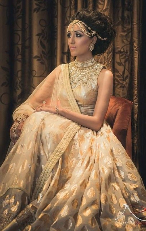 indian bride in a white and cream indian wedding dress