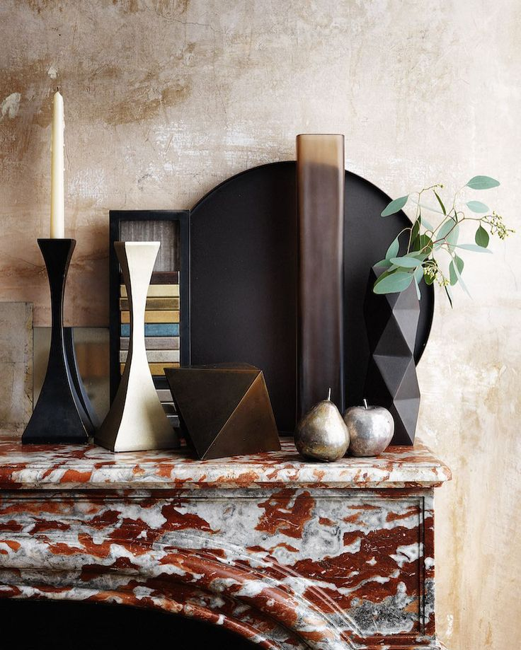 Beautiful bronzes and magnificent marble || Our Capricorn Candlesticks in patinated black steel and bronze