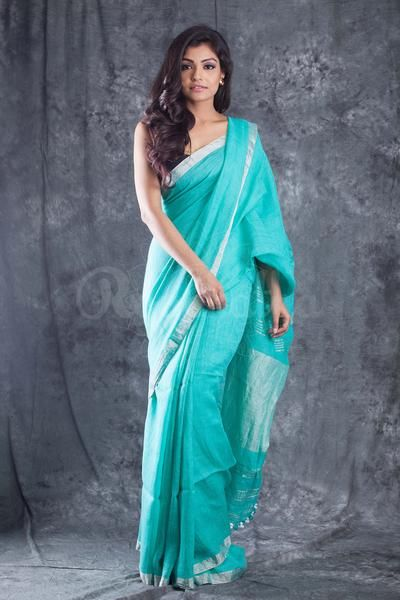 Wat a color!!!! Wow!!!!Sea Green Organic Linen Saree With Pompom & Silver Border - Roopkatha - A Story of Art