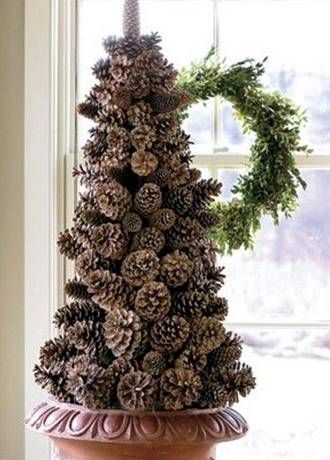 Handmade Christmas craft from pinecones photos
