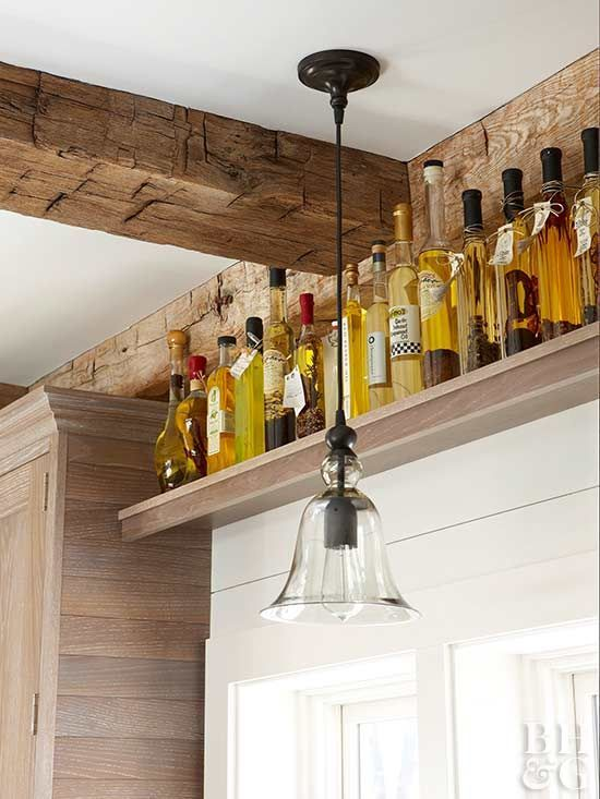 Capture unused space over a door or window by hanging a basic shelf above the frame. Use it to store off-season dishes, rarely used serving pieces, specialty cooking oils, or bottles of wine.