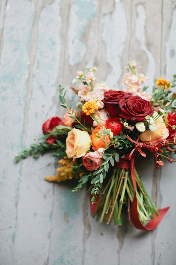 red orange fall wedding bouquet / http://www.himisspuff.com/fall-wedding-bouquets-for-autumn-brides/9/