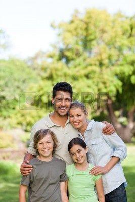 Familia feliz en el Parque Foto de archivo