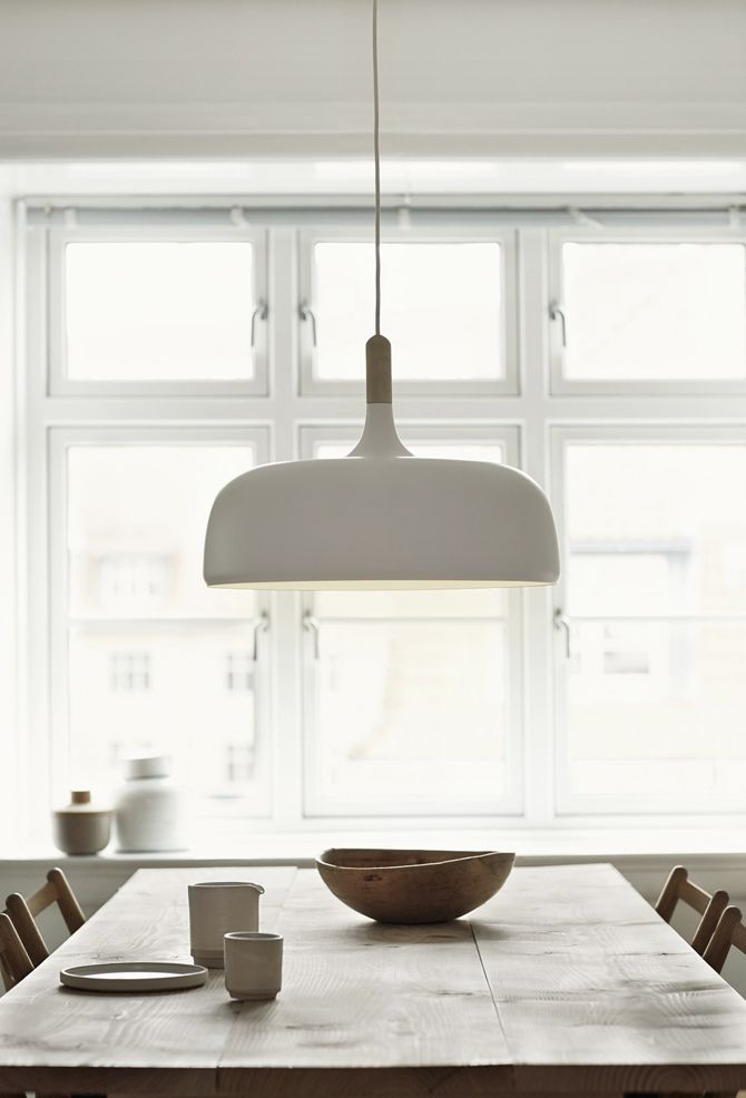 Large oversized pendant light above the dining table | Acorn, designed by  Atle Tveit for Northern Lighting, is inspired