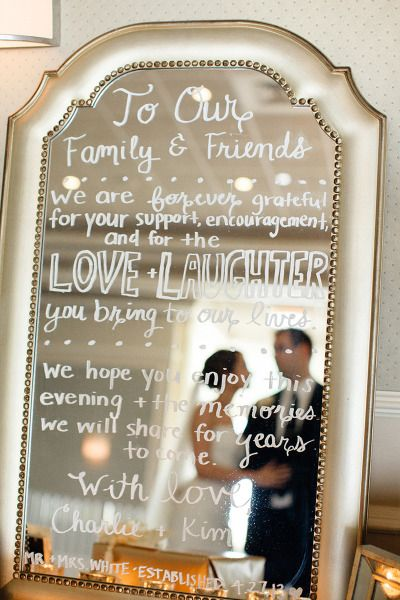 Mirror sign with bride and groom reflection: http://www.stylemepretty.com/florida-weddings/key-biscayne/2013/09/30/key-biscayne-wedding-at-the-rusty-pelican-from-elaine-palladino-photography/ | Photography: Elaine Palladino - http://www.elainepalladino.com/