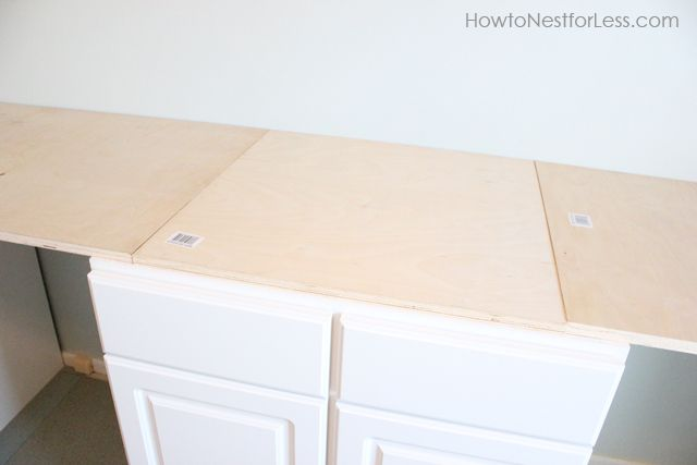 used 3/4 inch plywood. Make sure your pieces are flush across the top of the entire 10 foot desk. We laid out first at Lowe's so we wouldn't have any surprise ridges when we got home!