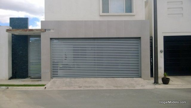 Puerta minimalista de garage con barras rectangulares - Puertas para garage ...