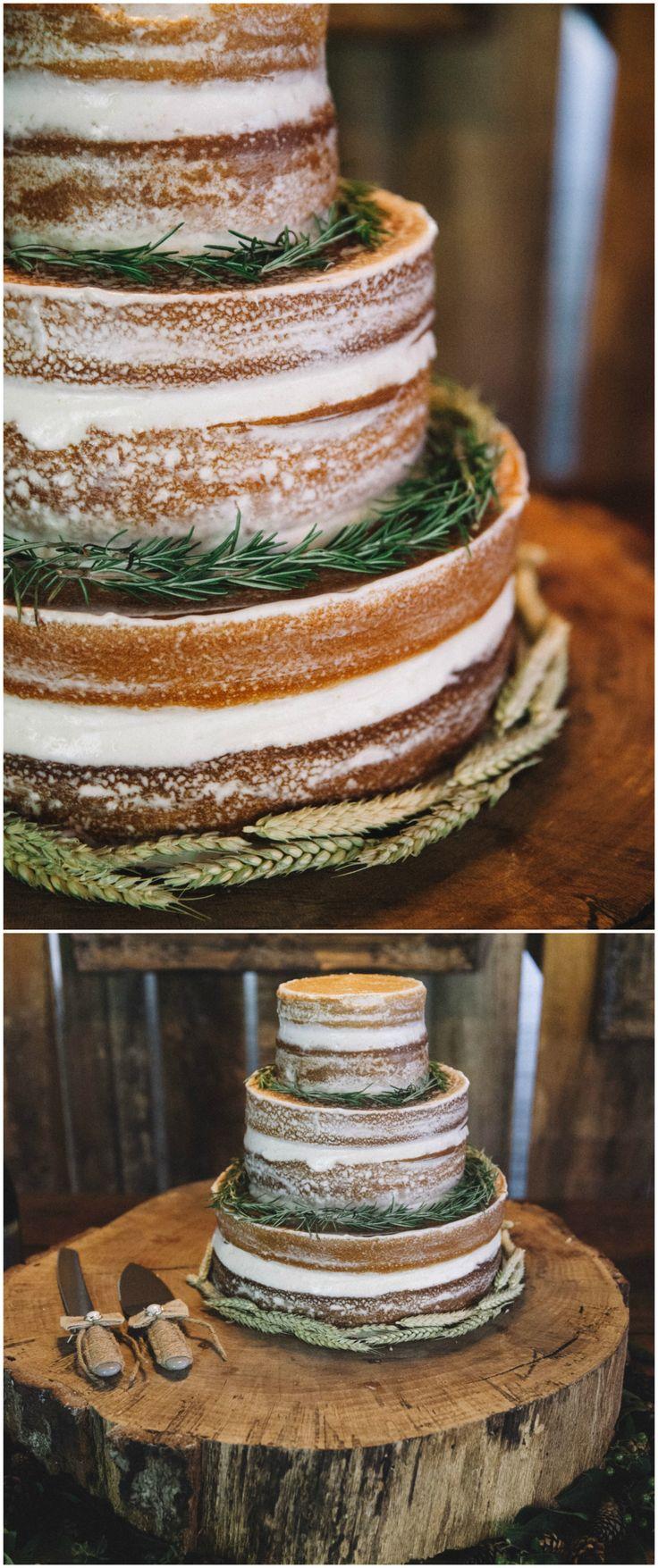 Natural wedding cake, naked cake, rustic cake stand, barn wedding reception dessert table, pine needles // Rachel Nichole Photography