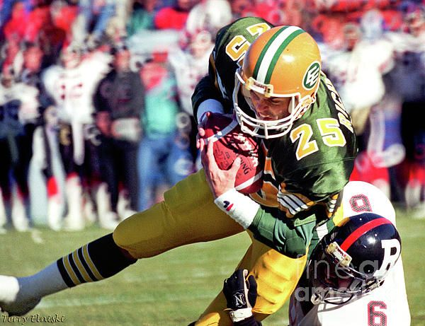 Photograph taken of Edmonton Eskimos receiver Tom Richards #25 catching a pass in a game versus the Ottawa Rough Riders, 1989.