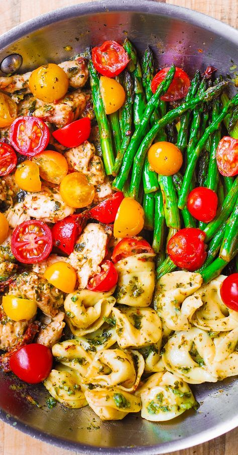 One-Pan Pesto Chicken, Tortellini, and Veggies, Asparagus, Tomatoes, Basil, Sun-Dried Tomatoes.  Healthy, gluten free, Mediterranean food.