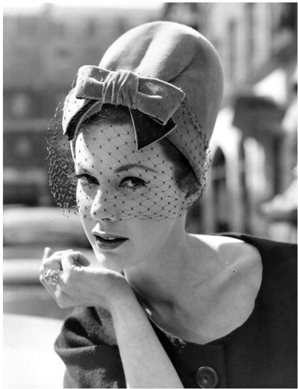1960 Christian Dior Chapeaux Ltd, being modelled in London by Jill Leslie, March