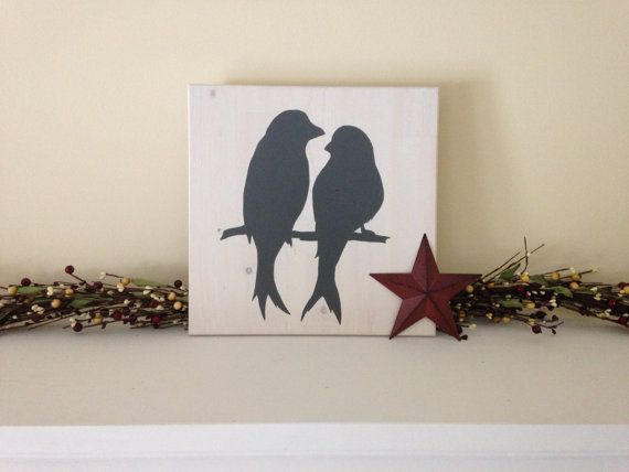 This simple barn swallow silhouette would be a great addition to your rustic home decor. Measures 12 x 12. Hand-painted with charcoal on a whitewashed background. Finished and protected with a clear topcoat. Designed to either hang easily on a single nail or to lean on a shelf or mantel.  Our silhouettes are inspired by animals typically found around country properties. Send us a message to create your own custom sign with your favourite animal