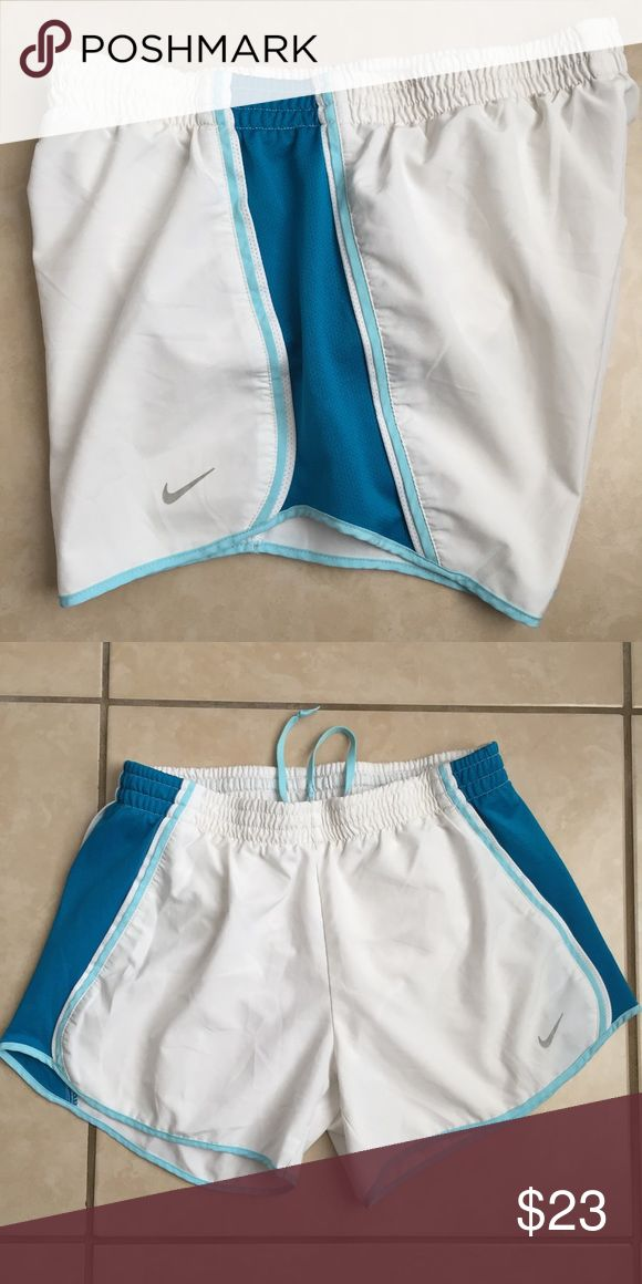 Nike + Dri-Fit LIKE NEW. Beautiful color. The Nike Tempo Shorts truly are a runner's dream. Women's athletic shorts Contrasting side panels with breathable mesh provide you with extra ventilation when you need it most, as well as fashionable athletic style. Convenient internal pockets and machine washable  Dri-FIT® fabric wicks sweat away and keeps you dry and comfortable Built-in briefs for ultimate coverage Nike® logo detail for authentic style 100% polyester Nike Shorts