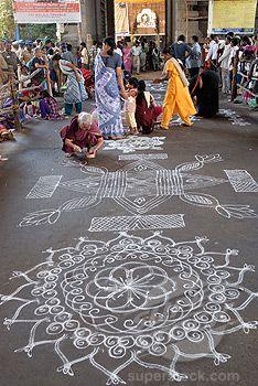 Women making kolam in front of a temple, Kapaleeshwarar Temple, Mylapore, Chennai, Tamil Nadu, India by V. Muthuraman