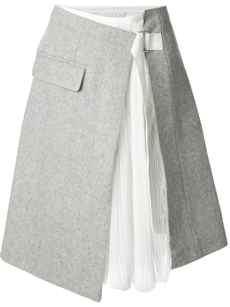 Sacai Wrap Skirt. The balance between formal and casual with twill skirt over a flared skirt.
