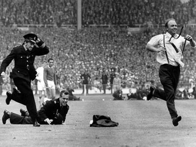 Eddie Cavanagh out strips diving police officer as he celebrates Everton's equaliser against Sheffield Wednesday in the 1966 FA Cup Final.