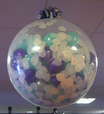 Fill an oversized balloon with tissue paper confetti and hang from ceiling.