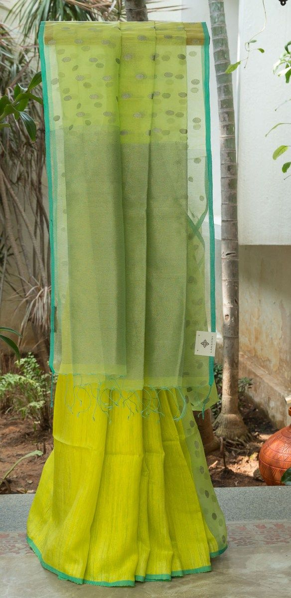 VIBRANT LIME GREEN HALF AND HALF BAILOU MATKA SILK HAS PLAIN PLEATS WHICH END IN A LONG POLKA DOTTED PALLU.