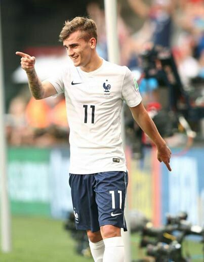 Antoine Griezmann, pointing towards what I imagine must be the Ballon d'Or he is going to win down the line. Athletico/France.