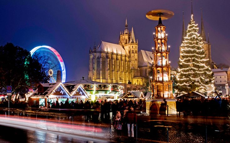 This picture taken with a long time exposure shows the Christmas market in front of the Mariendom (Cathedral of Mary) in Erfurt, central Germany