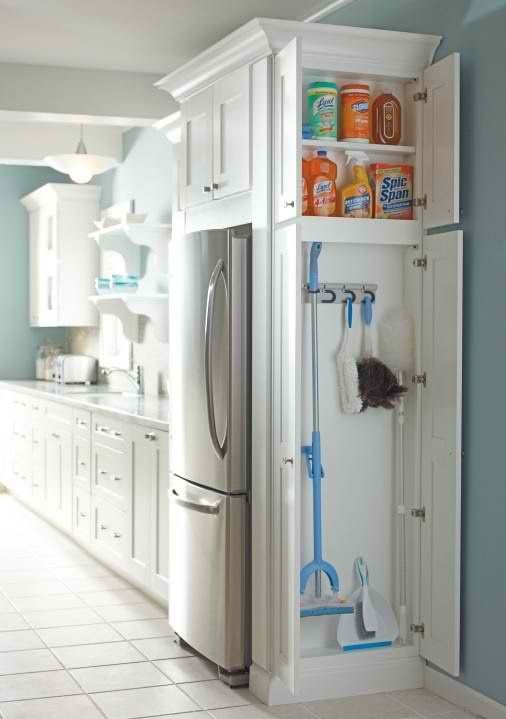 Kitchen storage, a clever way to incorporate your cleaning materials into an end unit vs filling your hall closets with kitchen necessities
