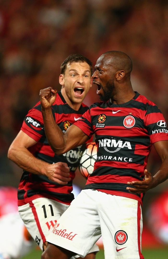 Romeo Castelen of Western Sydney Wanderers celebrates scoring one of his hat-trick with team mate Brendon Santalab. HAL SF WSW 5 Brisbane Roar 4 aet. Pirtek Stadium Sun. 24.04.16