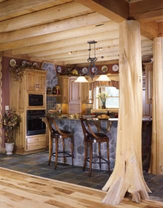 Log Home Kitchen With Tree Trunk Columns And Log Ceiling