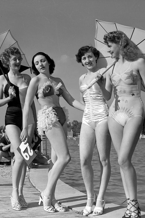 Swimsuit Competition, Paris, 1949. The 2-tone swimsuit is nice. The second from the right is mostly nice. The other two are ugly.