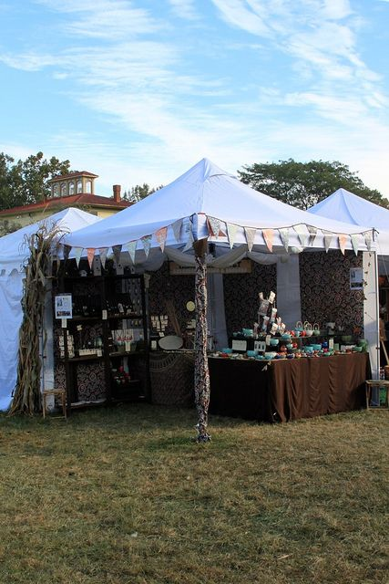 I like the fabric covering the corner pole. Country Living Fair by tashamck, via Flickr