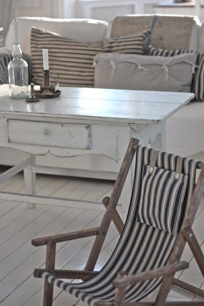 like for a back deck or patio -  white wooden floor / floorboards, sweet coffee table vintage style and nautical stripe deck chair loving xo