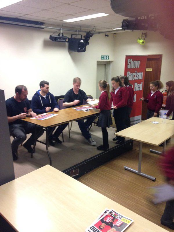 Bryncoch Church School pupils getting autographs from players Chris Jones and Alan Tate, along with former Wales player Steve Jenkins