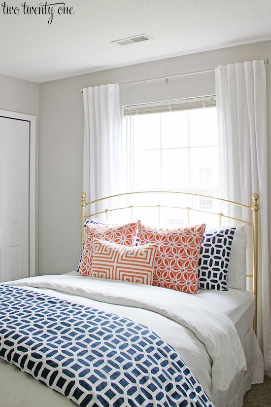 Home Tour of Two Twenty One blog.  Love the navy and coral bedding