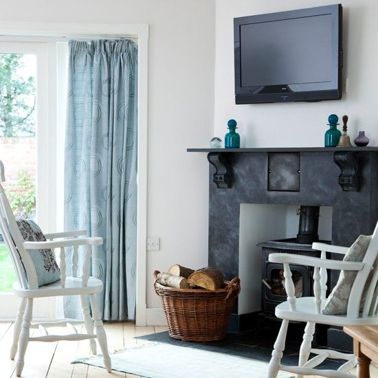 eggshell blue living room the faux slate fireplace is a central feature that really draws the eye the bare floorboards coupled with the simple blue - Slate Blue Living Room Ideas