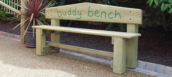 I LOVE this! It's a Buddy Bench. Children can go sit on it if they are feeling lonely or have nothing to do at recess. Other children that see someone sitting there are supposed to invite anyone sitting there to play. And lonely children that find each other there can invite each other to play! What a great idea!