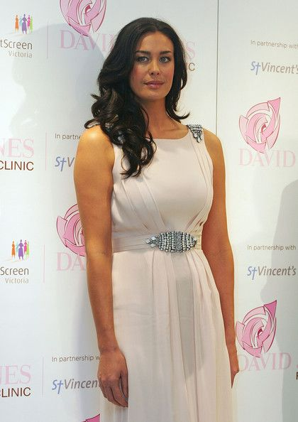 Hair Lookbook: Megan Gale wearing Long Curls (4 of 19). Megan Gale looked very girly at the New Women's Health Initiative event with her high-volume curly 'do.