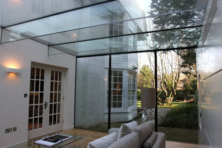 Glass Box extensions with Glass beams supporting the structural roof by IQ Glass