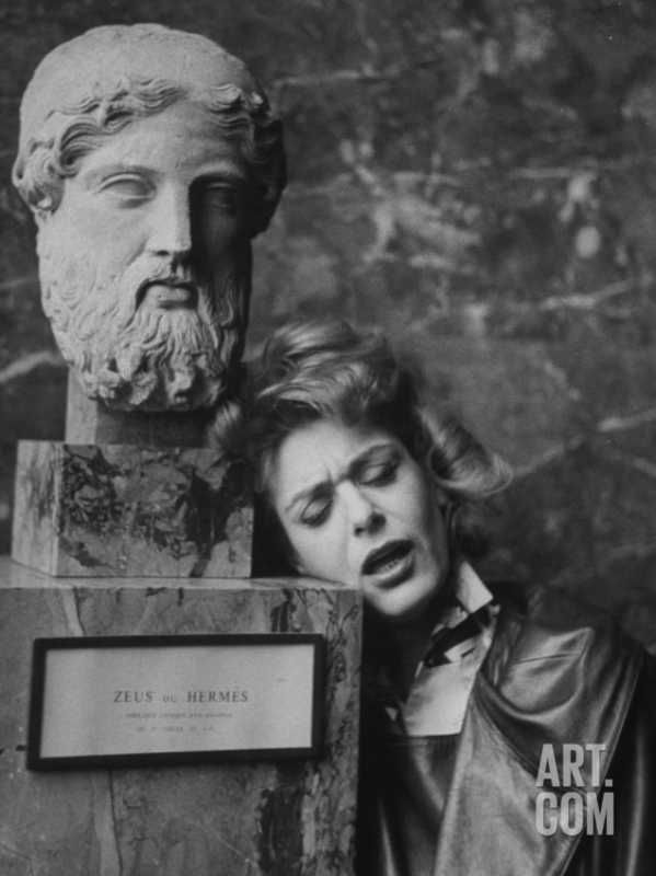 Melina Mercouri Leaning Her Head Against Pedestal Which Is Holding Bust of Zeus, at Louvre