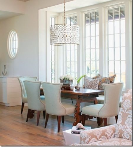 Chic Elegant Dining Room With Built In Banquette Doubling As Window Seat Oly Serena Drum Chandelier On Wood Ceiling Antique Table And Curvy Linen