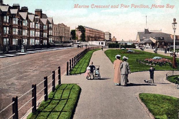 Promenading in Herne Bay. Pier to the side.