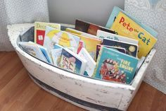 Boat bookcase for nautical nursery. (15 creative book storage ideas)