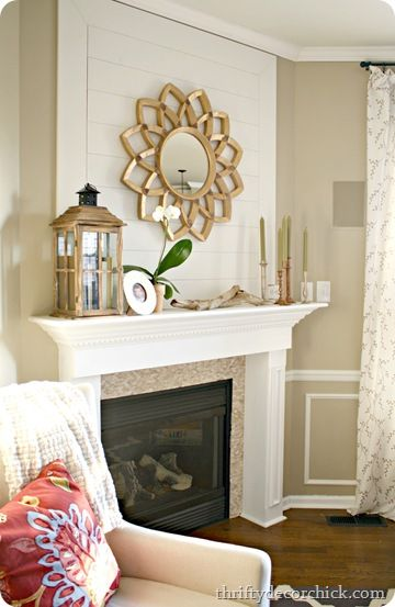 Wood plank wall fireplace starburst mirror thrifty decor - How to decorate a mantel with a mirror above it ...