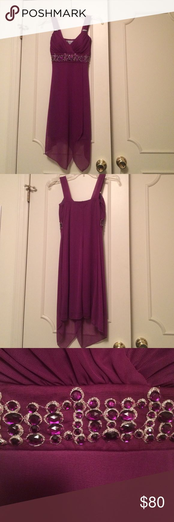 Purple formal dress Purple formal dress with purple rhinestone and silver colored embellishments. Worn once for a school social, no rips/tears or stains that I can see. I am under 5ft and this goes down to about halfway down my calf. Great if you have a small bust, 100% polyester offers welcome La Belle Dresses Midi
