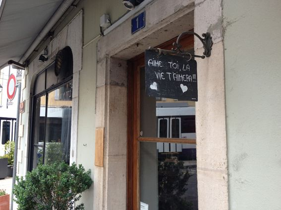 """""""Love yourself and life will love you""""   The sign hangs outside a dry cleaning business in Carouge, Geneva."""